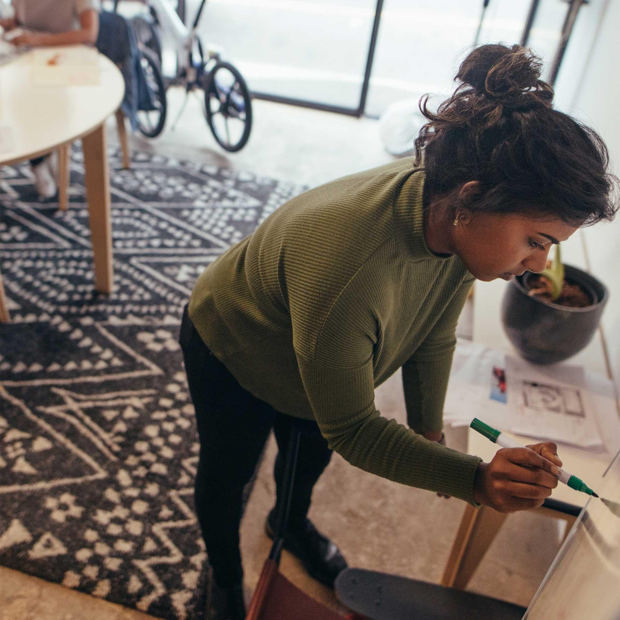 Creative Staff behind post-it note strewn window
