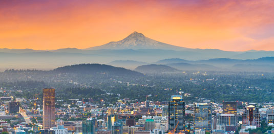 Skyline of Portland, Oregon, with Mt. Hood in the background. This is the home of Scion Portland Creative Staffing.