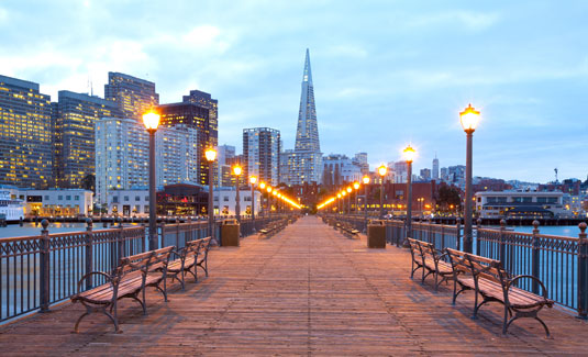 A dock with the skyline of San Francisco, California, behind it. This is the home of Scion San Francisco Creative Staffing