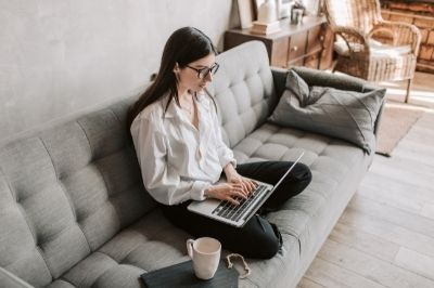 Working Remotely- woman working on her couch