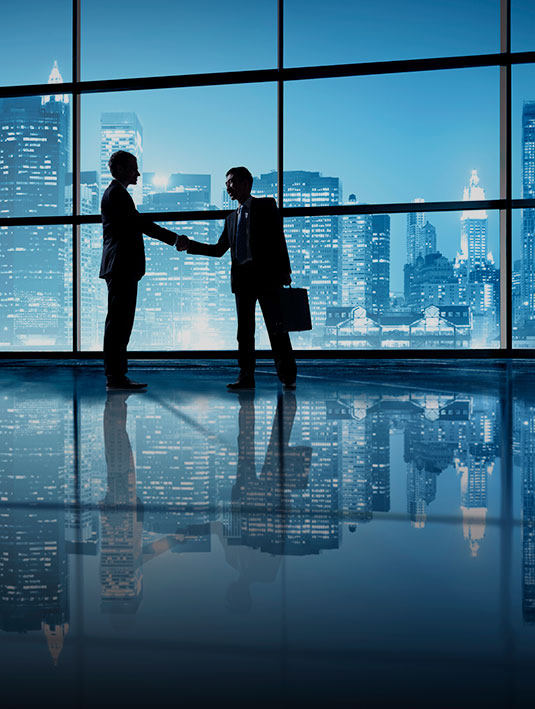 Executive Search Services Image showing two people meeting with New York City behind them.