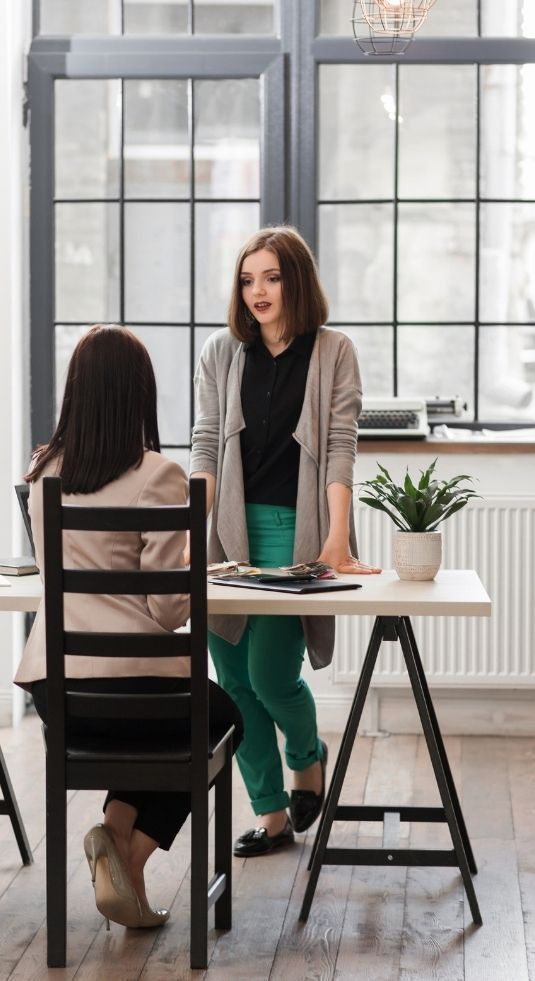 Two women in a Human Resources interview.